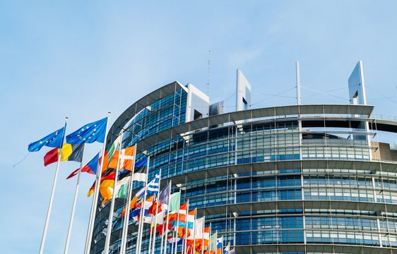 STRASBOURG, FRANCE - MAR 31 2017: The European Parliament building in Strasbourg, France with flags waving calmly celebrating peace of the Europe
