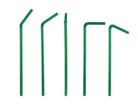 green plastic straws drinking isolated