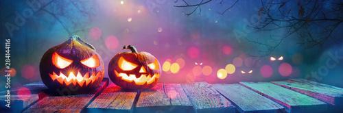 Jack O' Lanterns Glowing In Fantasy Night. Halloween Background