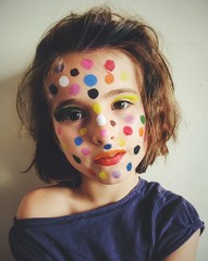 Portrait of a girl with polka dot make-up on her face