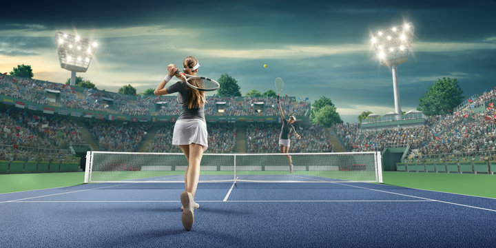 Female athlete plays tennis on a professional court