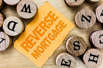 Handwriting text Reverse Mortgage. Concept meaning loan for seniors age above sixties and older to...