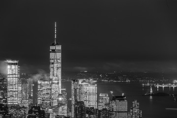 Fototapete - New York City skyline with lower Manhattan skyscrapers in storm at night. Black and white image.