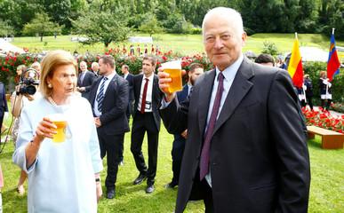 Prince Hans Adam II of Liechtenstein and wife Princess Marie hold glasses of beer during a party in the gardens of Schloss Vaduz castle in Vaduz