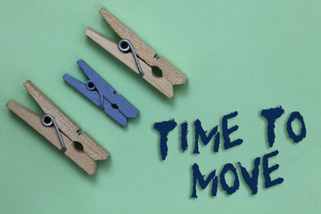 Conceptual hand writing showing Time To Move. Business photo showcasing Best period to transfer Relocation Change the current path Three brown blue vintage clear background Holding things