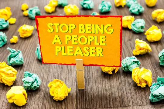 Handwriting text Stop Being A People Pleaser. Concept meaning Do what you like not things other people want Paperclip hold written yellow page colorful paper lobs laid on wooden floor