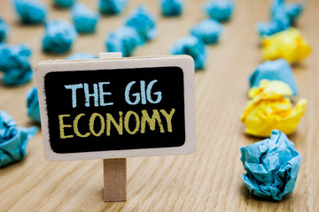Conceptual hand writing showing The Gig Economy. Business photo text Market of Short-term contracts freelance work temporary poster board with blurry paper lobs laid serially mid yellow lob Fotoväggar