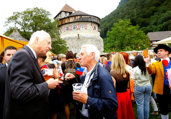 Frick takes a picture of Prince Hans-Adam II of Liechtenstein during a garden party celebrating the country's 300th birthday in Vaduz