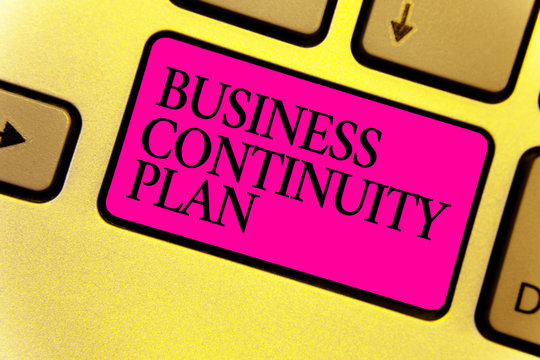 Writing note showing Business Continuity Plan. Business photo showcasing creating systems prevention deal potential threats Keyboard pink key Intention computer computing reflection document