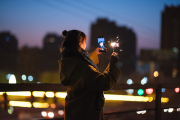 Young asian girl playing with sparklers on New Year's Eve