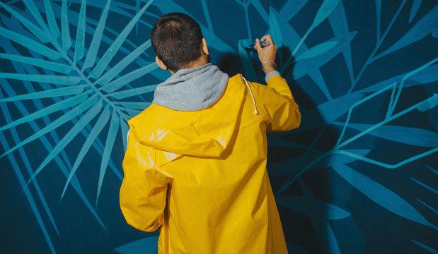 Street Artist Working On Mural.