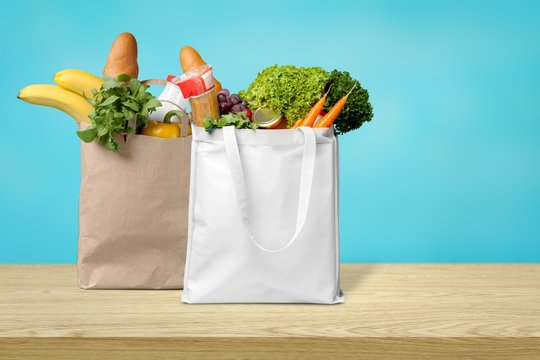 Shopping bags with groceries isolated on white background