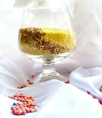 Buckwheat and rice in a glass cup. Useful food on a white background. Decor.