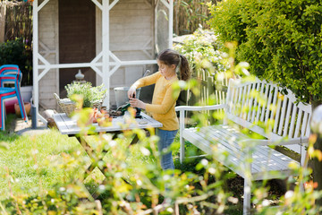 Girl gardening on garden table