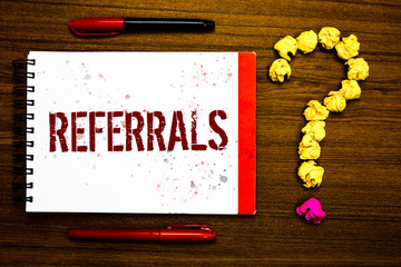 Conceptual hand writing showing Referrals. Business photo text Act of referring someone or something for consultation review Marker notepad nice art ask crumpled papers mistakes several tries