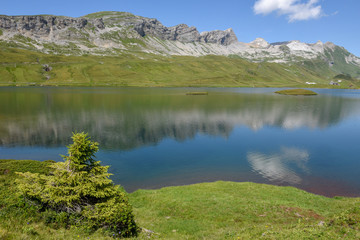 View at lake Tannensee over Engelberg in the Swiss alps