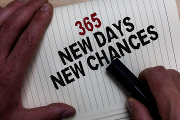 Word writing text 365 New Days New Chances. Business concept for Starting another year Calendar Opportunities Man's hand grasp black marker with some black and red texts on white page