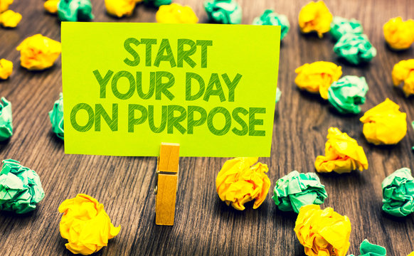 Handwriting text Start Your Day On Purpose. Concept meaning Have clean ideas of what you are going to do Paperclip retain written words yellow paper paper lobs laid on wooden floor