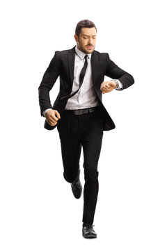 Young professional man in a suit running late
