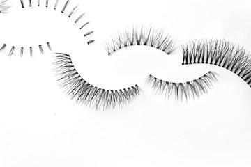 many false eye lashes on white back ground