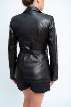 Womens leather jacket with long sleeves, black, with  iron lock.