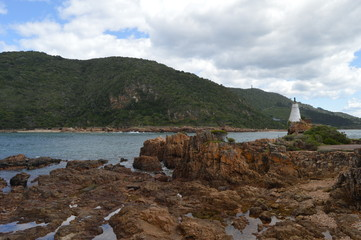 Beautiful rocky Knysna heads beach in garden route in Western Cape in South Africa where lagoon meets the sea