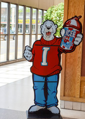 Crystal, Minnesota - May 6, 2018: Standing cardboard cutout of the Icee Polar Bear mascot advertising and promoting the slush puppy branded sweet sugary drinks