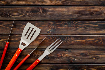 spatula, fork, tongs for barbecue on wooden background top view mock-up Wall mural