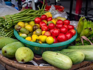 Pattaya, Thailand - August 1, 2019: Collection of fruits and vegetables found at a road side stall selling fresh thai street papaya salad