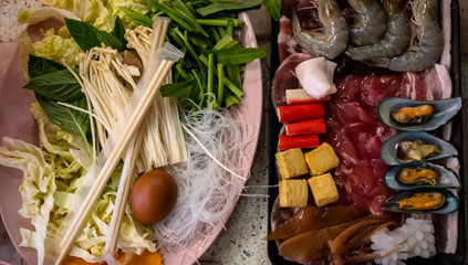 Pattaya, Thailand - August 1, 2019: Traditional Thai Barbeque BBQ with seafood, beef and pork and a mixture of vegetables and mushrooms. Perfect meal for sharing