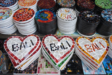 Placemats in a shap of a heart with the name Bali in souvenirs shop in Ubud market Bali Indonesia
