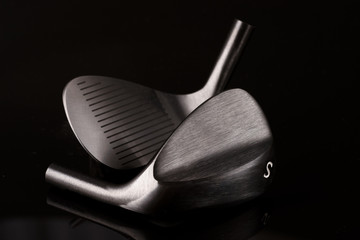 Forged Sand Wedges Heads on a Black Background. Golf Equipment