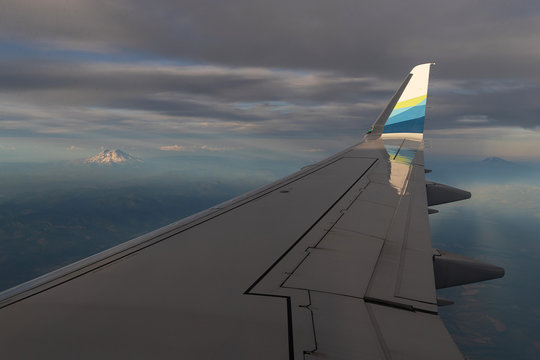 Alaska Airlines wing in flight under cloudy sky over the Pacific Northwest on August  13, 2019