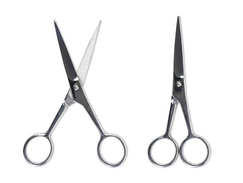 Top view of vintage gold and silver scissors isolated on white