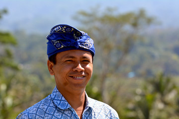Happy Balinese man smiling outdoors in Bali Indonesia