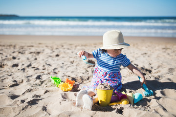 toddler girl playing at summer sand beach,Northern Ireland