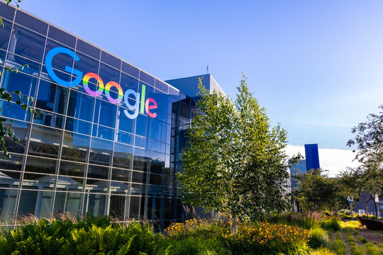 "June 8, 2019 Mountain View / CA / USA - Google office building in the Company's campus in Silicon Valley; The ""double o's"" of the logo are decorated in rainbow colors in honor of LGBTQ Rights"