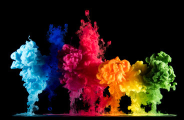 Colorful paint drops from above mixing in water. Ink swirling underwater Fototapete