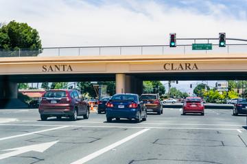 June 15, 2019 Santa Clara / CA / USA - Cars driving on El Camino Real through Silicon Valley in South San Francisco bay area; Santa Clara city boundary marked on an overpass;