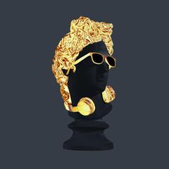 Statue. Gold earphones on a grey background. Gypsum statue of David's head. Creative. Plaster statue of Apollo's head in gold sunglasses. Minimal concept art.