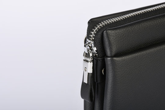 Black leather bag zipper detail isolated on white background