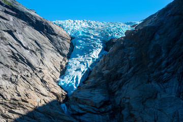 Briksdal or Briksdalsbreen glacier with melting blue ice.