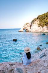 Photo sur Aluminium Chypre The beautiful bay in the Gulf of Orosei, Sardinia Cala Goloritze, young girl in dress looking out over the beach of Cala Goloritze