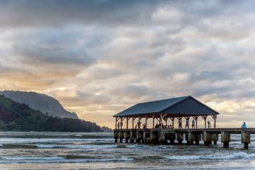 People enjoying sunset on Hanalei Bay Pier, Kauai