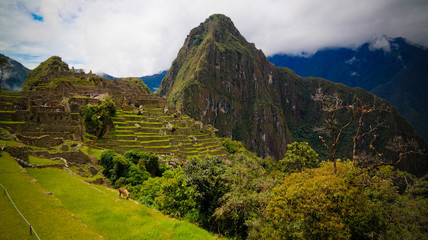 Panoramic view to Machu Picchu archaeological site and Huayna Picchu mountain , Cuzco, Peru