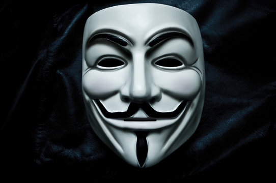 Vendetta mask on black bacground . This mask is a well-known symbol for the online hacktivist group Anonymous