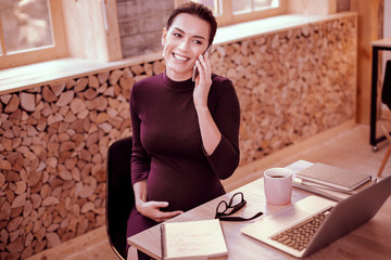 Cheerful young woman spending time in office