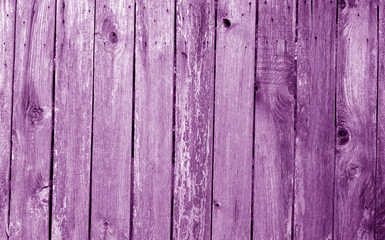 Weathered wooden fence in purple color.