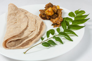 Indian Chapati and Chicken roast on a white plate