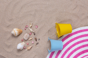 Colorful summer female fashion outfit flat-lay on sand. Summer fashion or holiday travel concept